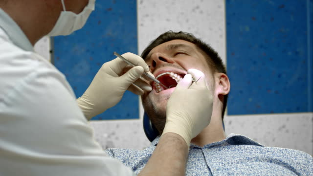 Dentist having view of client teeth video