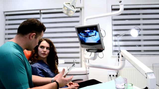 DOLLY: Dentist informing patient via digital tablet video