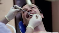 Dentist makes the process of treatment in dental clinic office. video