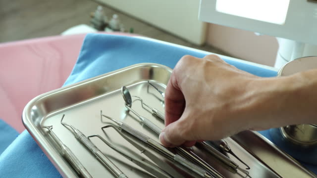 A dentist starts to examine a patient. video