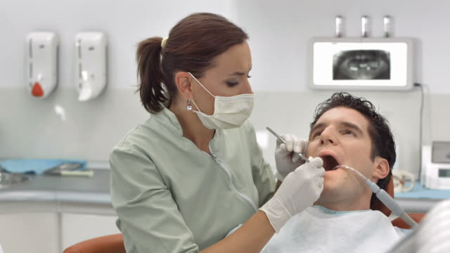HD DOLLY: Dentist Treating Patient's Teeth video
