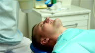 Dentist Visiting Man As Patient In Dental Clinic. video