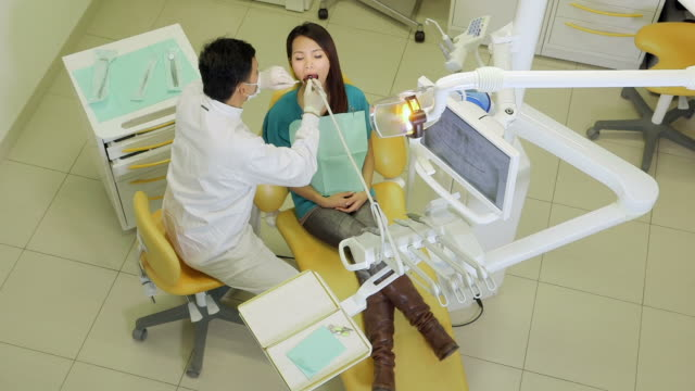 Dentist visiting patient in dental studio, health and doctor video