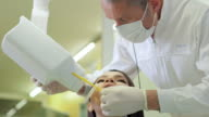 Dentist visiting patient in dental studio video