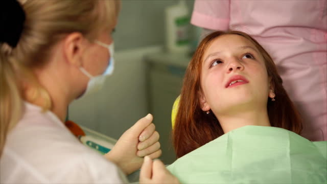 A dentist who made anesthesia asks a teenage girl how she feels video