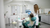 dentist with x-ray and girl patient video