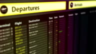 Departures sign board with flight information, destination cities on timetable video