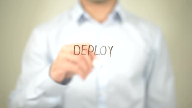 Deploy, Man writing on transparent screen video