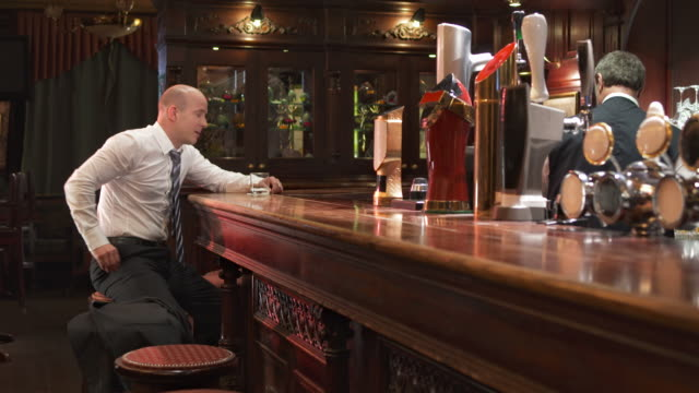 HD DOLLY: Depressed Businessman Leaving The Bar video