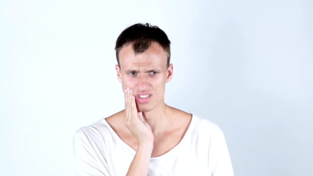 Depressed ill man having toothache and touching cheek video