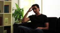 Depressed man at home video