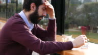 Depressed man in a cafe video