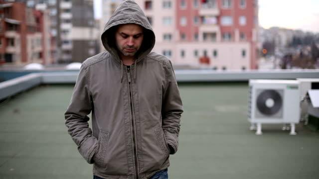 Depressed man walking on roof video