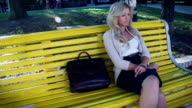 Depressed sad blond business woman in park problems at work video