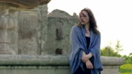 Depressed woman alone in ancient park video