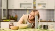 Depressed woman in the kitchen video