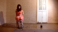 Depressed woman  tied to a stool. video