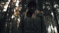 Depressed young woman in the forest video