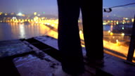Depression, lonely barefoot male standing on top of bridge, suicidal thoughts video