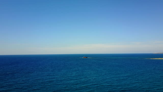 depths of the sea with the ship. Infinite space of water and sky. Horizon. video