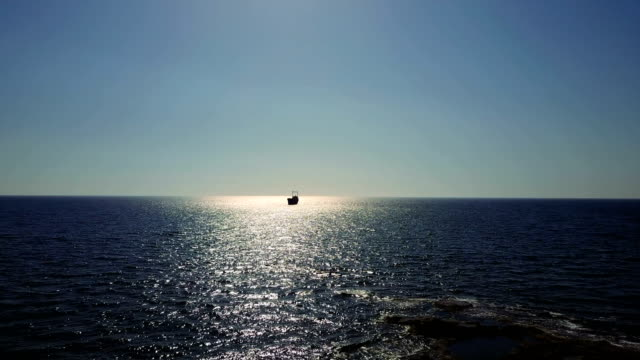 depths of the sea with the ship. Infinite space of water and sky. Horizon video