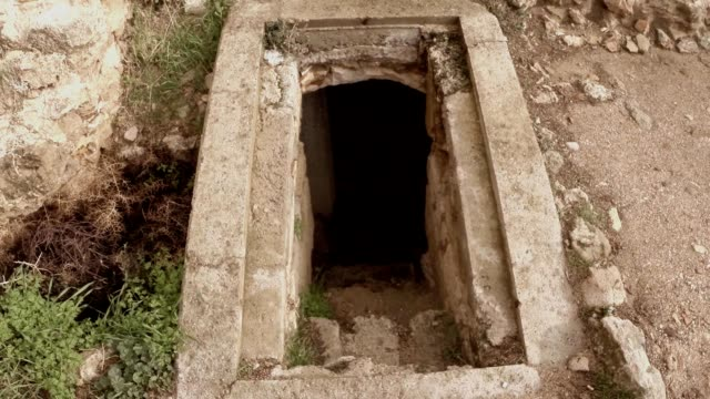Descent into underground rooms ruins antique roman baths old town Salamis east Cyprus video