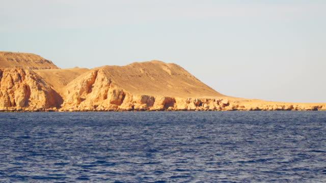 Deserted rocky shore video
