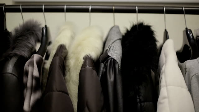 Design collection of winter clothing on hangers. video