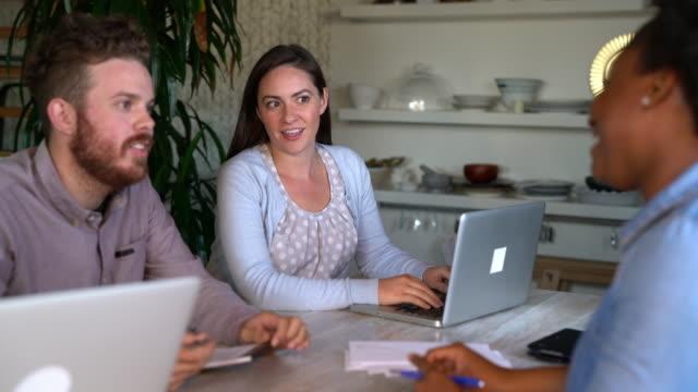 Design team having a conversation around a desk video