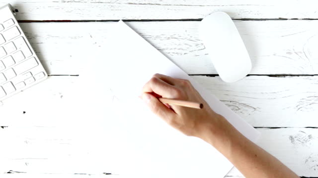 Designer feeling inspired: accelerated footage of a woman sketching with a pencil video