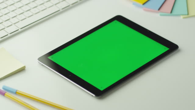 Designer is Using Tablet with Green Screen in Landscape Mode. video