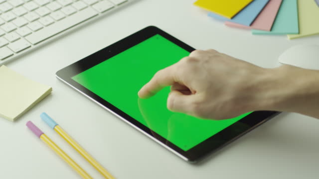Designer is Using Tablet with Green Screen in Portrait Mode. video