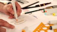 Designer sketching and drawing video