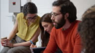 Designers Sitting On Sofa Having Creative Meeting In Office video