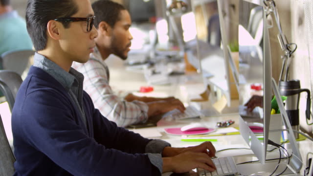 Designers Working At Computers In Modern Office Shot On R3D video