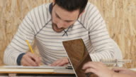 Designers working in design studio video