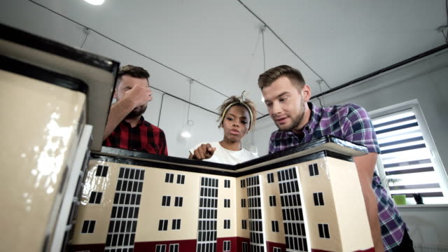 Designers working with mockup of house video
