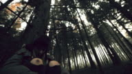 Despaired young woman freezing in the forest video