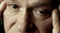 desperate old man closeup portrait video
