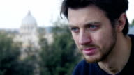 desperate young man crying for love with st. Peter dome in background video