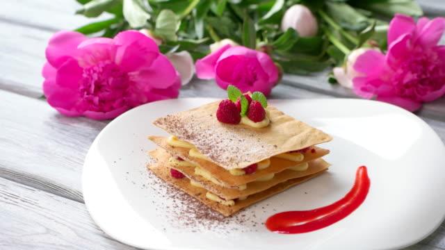 Dessert with raspberry on plate. video