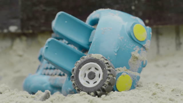 Destroyed Blue Toy Car On Sand, Playground video