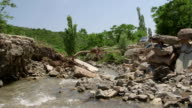 Destroyed concrete bridge over a mountain river by a flood after heavy rain video