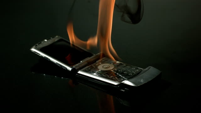Destroying an old cell phone with fire and hammer video