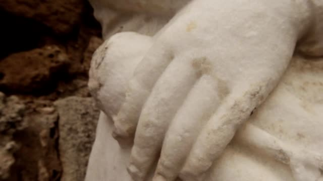 Detail hand of antique white headless statue ancient town Salamis east Cyprus Famagusta video