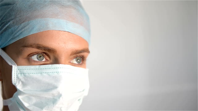 Detail of female doctor wearing surgical mask video