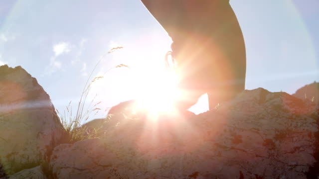 LOW ANGLE: Detail of leather mountain shoes and female climbing steep mountain video