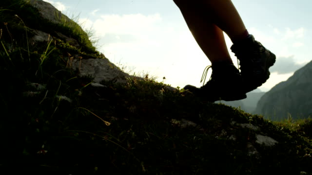 CLOSE UP: Detail of leather mountain shoes and woman climbing steep mountain video