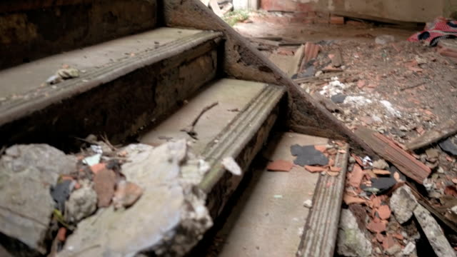 CLOSE UP: Detail of ruined cracked stone staircase in decaying abandoned castle video
