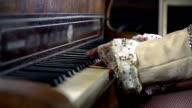 HD SLOW: Detail shot of mistress hands pressing piano keys video
